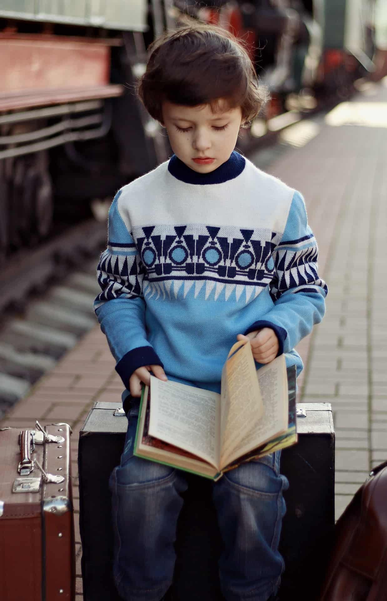 How to Encourage Reading for Children - Reading while waiting for a train. How to develop reading habit in kids